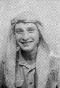 Ray adopts local head gear to cope with the heat when serving in North Africa in WW II